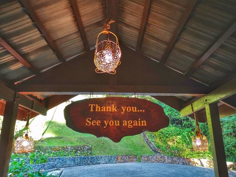 Thank you and see you again signage on wooden hanging top.