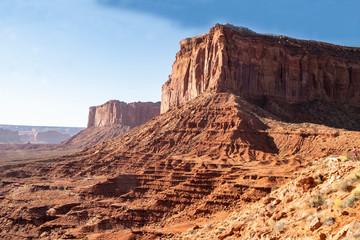 Monument Valley famous rock formations under a blue sky. Fotoväggar