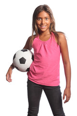 Smiling mixed race school girl holding football