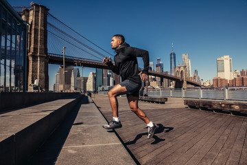 Athelte man running in New York City street wearing sport clothes