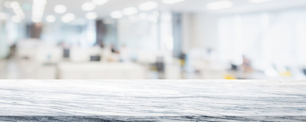 Empty white marble stone table top on blurred with bokeh co working office space interior banner background - can be used for display or montage your products