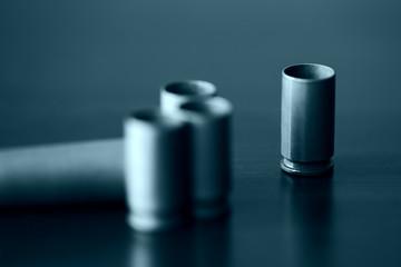 Empty old bullet cartridges close up. Blue color toned