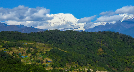 Panoramic view of Makalu mountain in the background, rice fields and forests in the foreground, Nepal