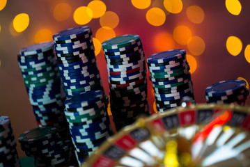 Casino theme. High contrast image of casino roulette, and poker chips