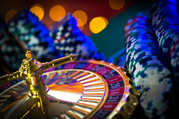 Poster Amusementspark Casino theme. High contrast image of casino roulette, and poker chips