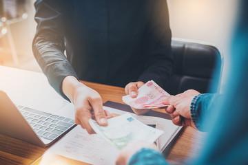 Exchange money, Business peoople exchange Euro money for Yuan RMB (Chinese money)