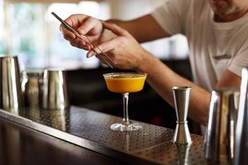 waiter finishing a cocktail decoration