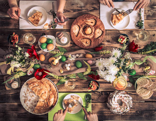 Apartment-feast of friends or family at the festive table with rabbit meat, vegetables, pies, eggs, top view.