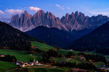 Fototapete - Santa Maddalena village with magical Dolomites mountains in background, Val di Funes valley, Trentino Alto Adige region, Italy, Europe. Night view of dramatic Italian Dolomites landscape.