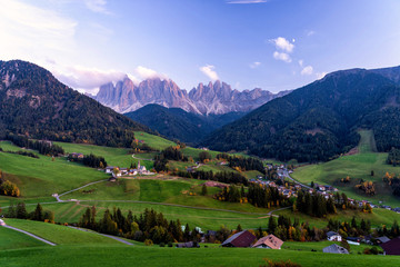 Fototapete - Santa Maddalena village with magical Dolomites mountains in background, Val di Funes valley, Trentino Alto Adige region, Italy, Europe. Blue hour view of dramatic Italian Dolomites landscape.