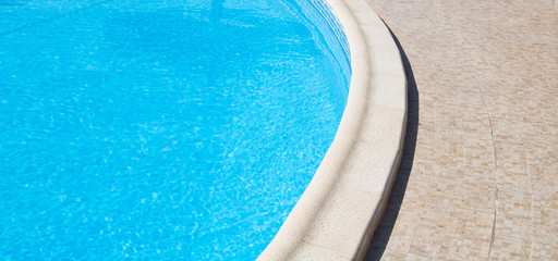 Outdoor swimming pool with stone curve border