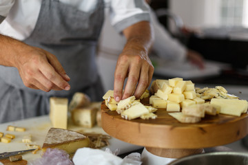 chef preparing a plate of cheese
