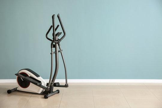 Modern machine near color wall in gym
