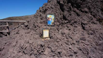Vesuv Volcano crater and path around it with a shrine an picture of a saint, madonna