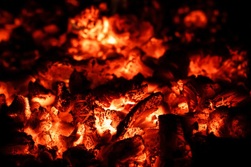 Hot coals in fireplace, fire background, close-up, macro.