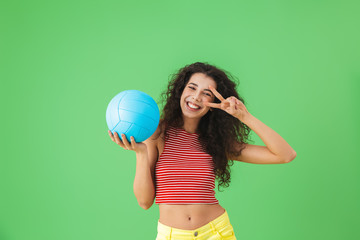 Image of delighted woman 20s wearing summer clothes smiling and holding volley ball