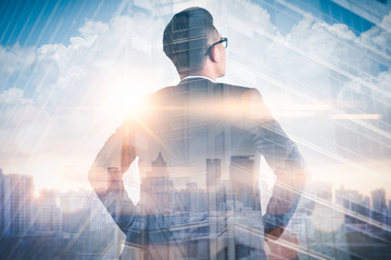 The double exposure image of the businessman standing back during sunrise overlay with cityscape image. The concept of modern life, business, city life and internet of things. Wall mural