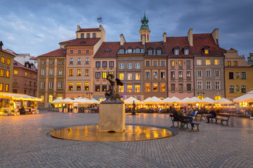 Statue of mermaid in Warsaw old town at dusk, Poland