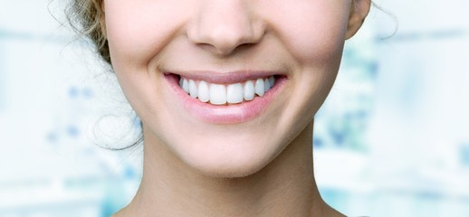 Beautiful wide smile of young fresh woman with great healthy white teeth. Isolated over background Fototapete