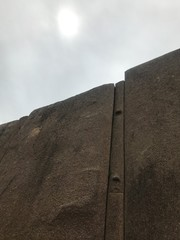 Sun and Wall of a Inca Ruin in Peru