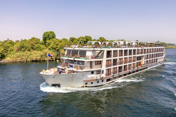 A tourist boat motor down the River Nile towards Aswan in central Egypt. The tourist boats cruise between Luxor and Aswan in Upper Egypt
