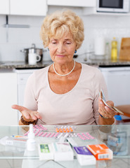 Woman counting her expenditure on medicines