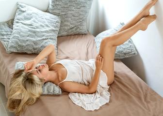 beautiful girl lying on the sofa at home