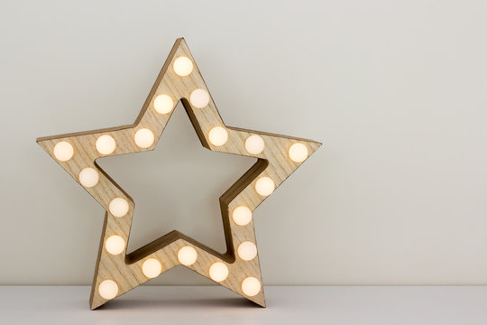Star-shaped wooden lamp