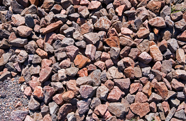 Backgrounds: Close-up of gravel between railway sleepers in the early spring sun