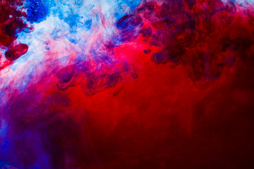 colorful paints dissolve in water, abstract background