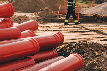Plastic sewer pipes on construction site for repairing