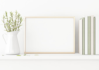 Horizontal poster mockup with golden metal frame standing on table and decorated with jug, green plants and pile of books on empty white wall background. 3D rendering, illustration.