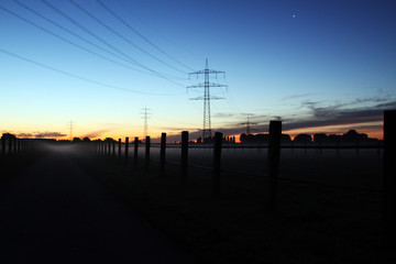 Sunset in countryside electrical tower