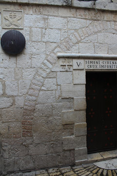 Via Dolorosa, the fifth station, Simon of Cyrene helps Jesus to carry his cross