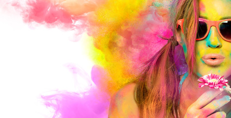 Beautiful young woman celebrating the Holi festival. Colors festival. Beauty spring concept