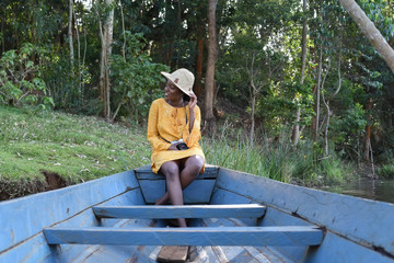 young woman sitting in a boat in Kenya