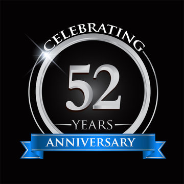 Celebrating 52 years anniversary logo. with silver ring and blue ribbon.