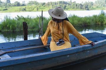 woman sitting in a boat in Kenya