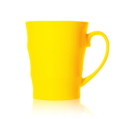 Yellow porcelain mug isolated on a white background, mock up