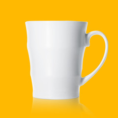 White porcelain mug isolated on orange background, mockup