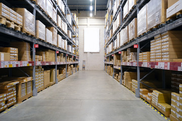 Warehouse-shop. The interior of the warehouse. The shelves in several rows.
