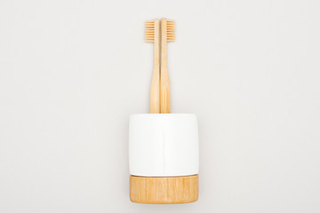 bamboo toothbrushes in stand on grey background Wall mural