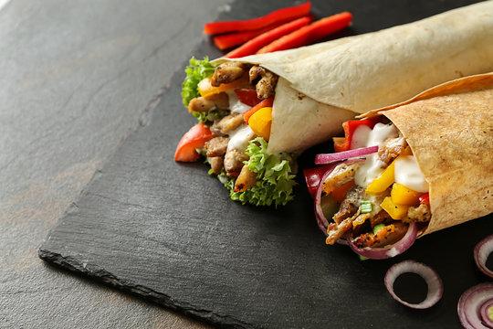 Tasty doner kebabs on slate plate