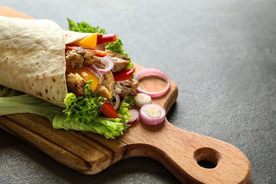 Tasty doner kebab on wooden board