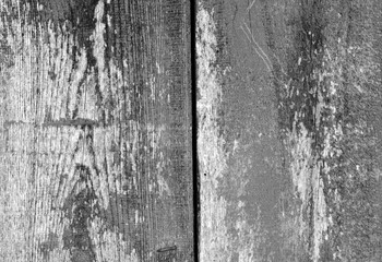 Old grungy wooden planks background in black and white.