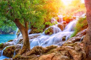 Amazing nature landscape, beautiful waterfall at sunrise, famous Skradinski buk, one of the most beautiful waterfalls in Europe and the biggest in Croatia, outdoor travel background Fototapete