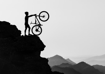 Clyclist at the top of the mountain 5