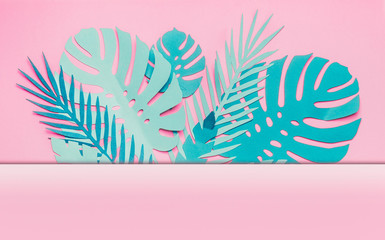 Wall Mural - Various turquoise blue tropical leaves frame or border with copy space for your design on pastel pink background. Creative layout made with papercraft