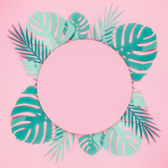 Wall Mural - Various turquoise blue tropical leaves made with papercraft with round circle copy space for your design on pastel pink background. Creative layout