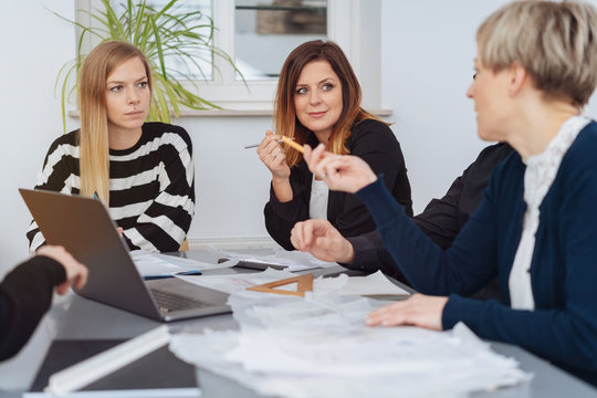 Businesswoman gesturing at a female colleague